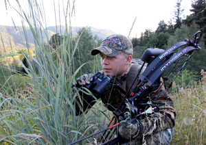 Bow hunter in the field with his compound bow