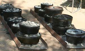 Dutch Ovens Lined Up for Cooking
