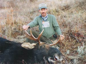 Hunter With Bull Moose