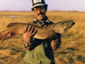 Angler holding Northern Pike