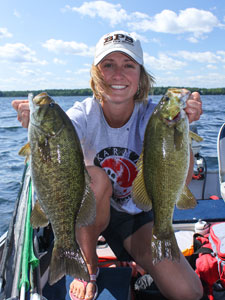 Lady angler with two smallmouth bass