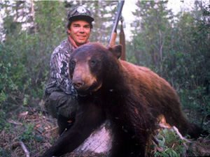 Hunter with bagged black bear