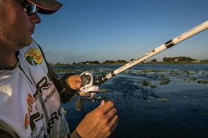 A baitcast reel rigged to a fishing rod
