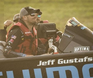 Jeff Gustafson driving boat