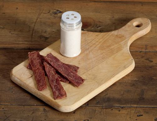 Strips of basic jerky meat on a cutting board