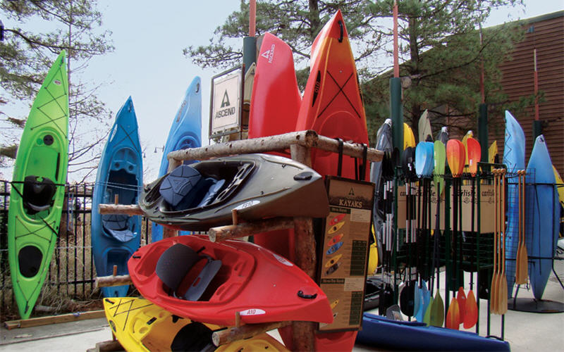 Kayaks stacked upright at Bass Pro store
