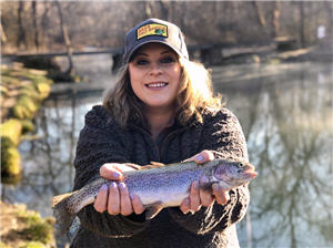 Lady trout anlgler holding her catch