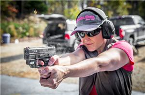 Lady shooting a pistol for practice