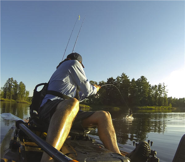 reeling in fish kayak