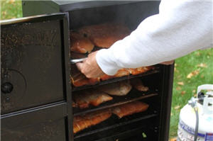 A removing meat from a smoker