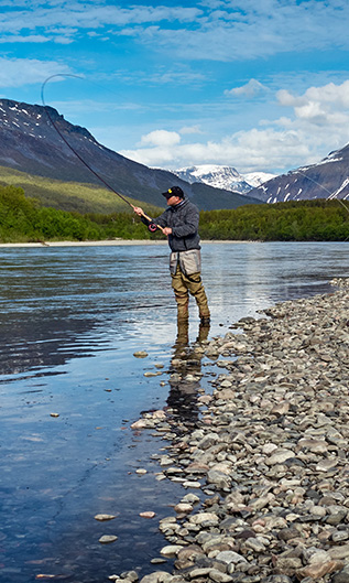 Fly Fisherman Casting in the Mountains
