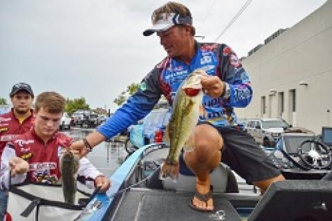 Reigning FLW Tour AOY Scott Martin bagging his catch at the 2015 Forrest Wood Cup by Reigning FLW Tour AOY Scott Martin bagging his catch at the 2015 Forrest Wood Cup...