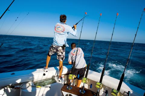 2 saltwater anglers fishing from boat