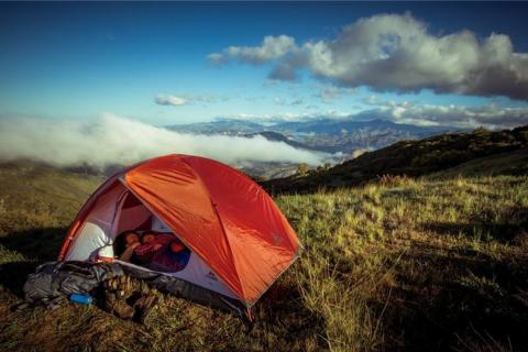 two hikers & tent