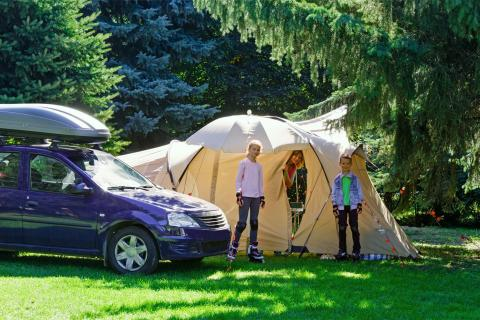 Family setting up camp with tent