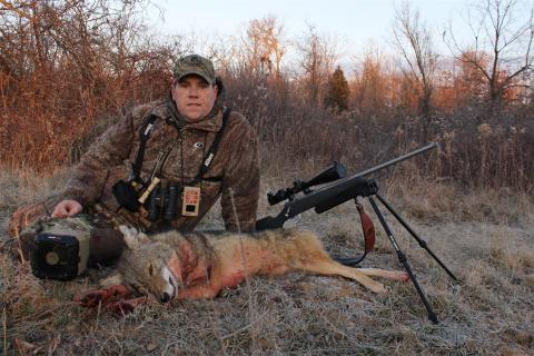 Predator hunter with his harvested coyote