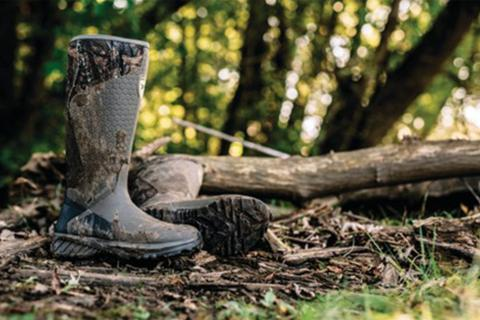 rubber boots next to tree