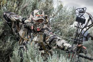 A bow hunter in camo clothing