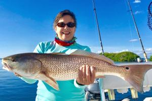 Angler with Red Drum fish