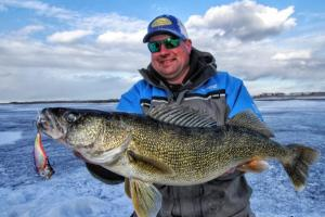 The author Jason Mitchell with a nice late ice walleye