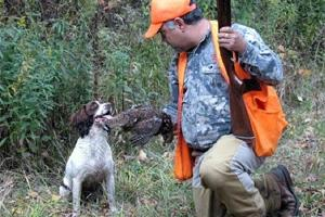 Grouse hunter and dog