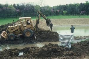 Men digging a farm pond