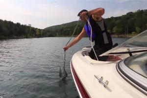Boater raising up a boat anchor