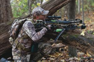 Bow hunter with crossbow