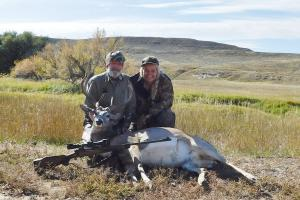 Hunter with mule deer he shot