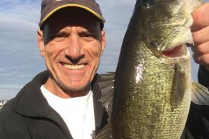 Angler holding his Trophy Bass