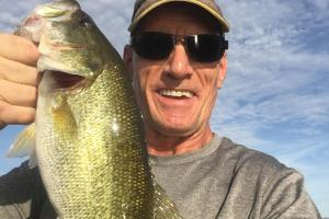 Angler Bruce Scheub holding up his Big Bass