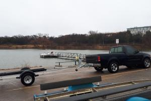 Grapevine Lake, Texas boat ramp with truck and boat trailers