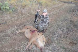 Young boy is a proud Hog Hunter