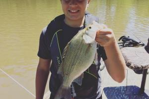 Young boy stripe bass fishing