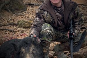 Wild pig hunter with wild pig he shot