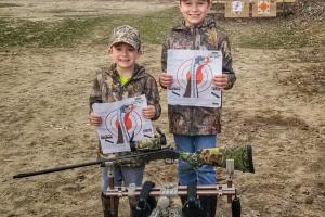 Two young hunters target shooting practice before turkey hunt