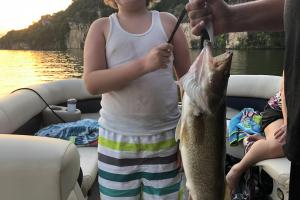 Young angler holding walleye