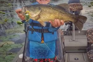 Young boy holding a bass