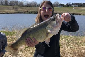 Lady angler holding a big bass