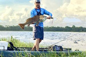 Angler with large redfish
