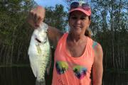 Women standing with a large white crappie from Lake Conroe