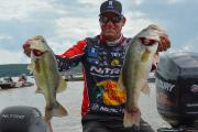 Kevin VanDam just after a fishing tournament holding up two of his largest bass