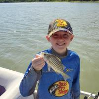 Oliver  holding small stripe bass