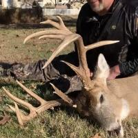 Proud hunter with buck harvest