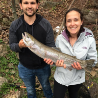 couple holding trout